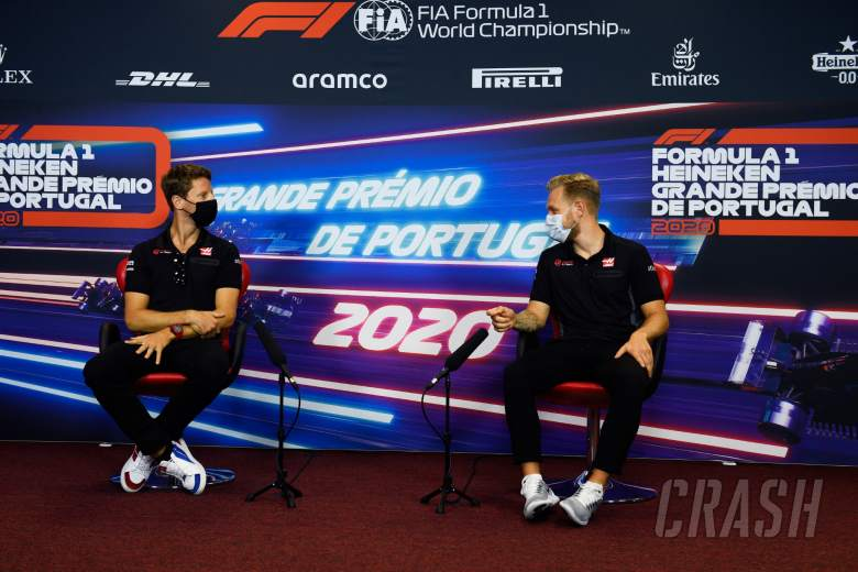(L to R): Romain Grosjean (FRA) Haas F1 Team and team mate Kevin Magnussen (DEN) Haas F1 Team in the FIA Press Conference.