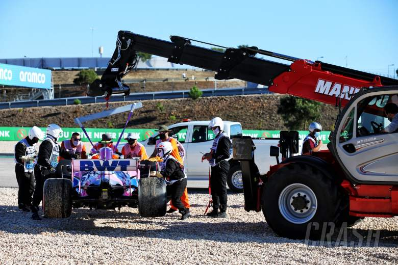 The Racing Point F1 Team RP20 of Lance Stroll (CDN) is removed from the gravel trap by marshals after he crashed in the second practice session.
