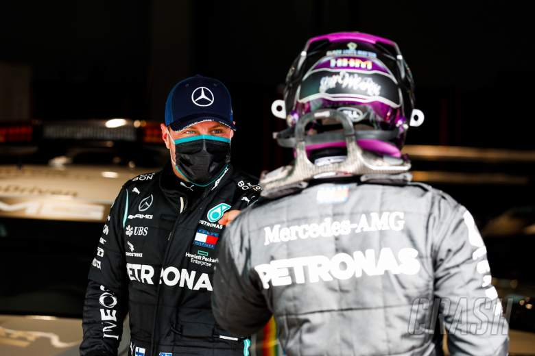 (L to R): Valtteri Bottas (FIN) Mercedes AMG F1 with team mate Lewis Hamilton (GBR) Mercedes AMG F1 in qualifying parc ferme.