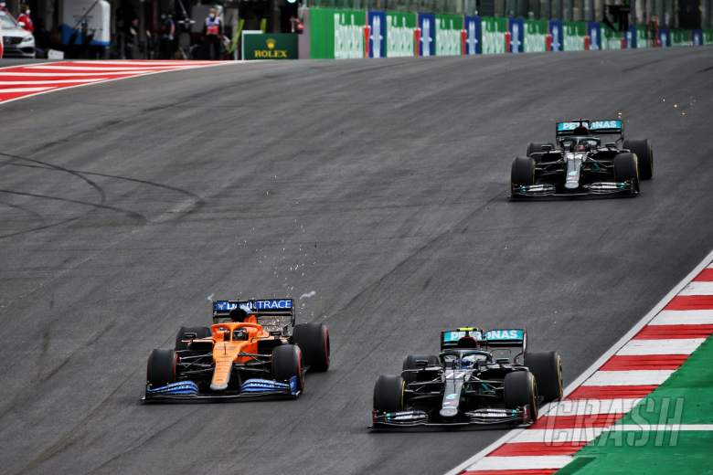 (L to R): Carlos Sainz Jr (ESP) McLaren MCL35 and Valtteri Bottas (FIN) Mercedes AMG F1 W11 battle for the lead of the race.