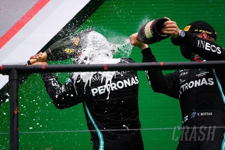Race winner Lewis Hamilton (GBR) Mercedes AMG F1 celebrates on the podium with Valtteri Bottas (FIN) Mercedes AMG F1.