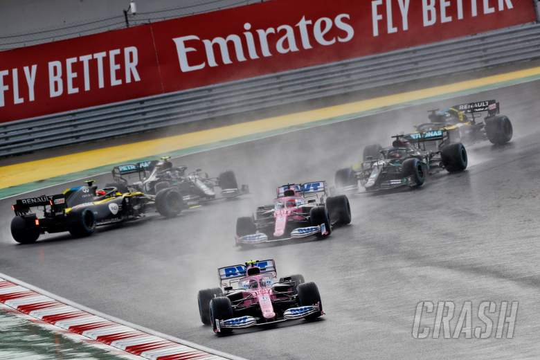 Lance Stroll (CDN) Racing Point F1 Team RP20 leads at the start of the race as Esteban Ocon (FRA) Renault F1 Team RS20 and Valtteri Bottas (FIN) Mercedes AMG F1 W11 spin off the circuit.