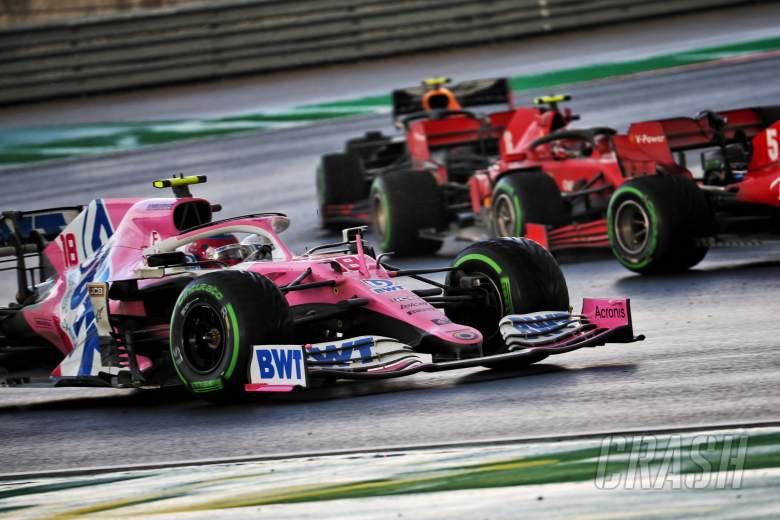Lance Stroll (CDN) Racing Point F1 Team RP20 and Sebastian Vettel (GER) Ferrari SF1000 battle for position.