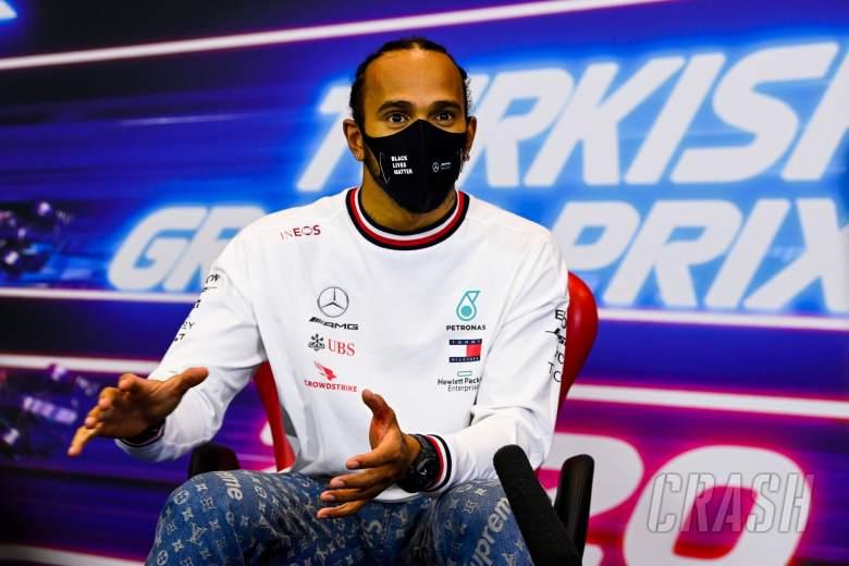 Race winner and World Champion Lewis Hamilton (GBR)