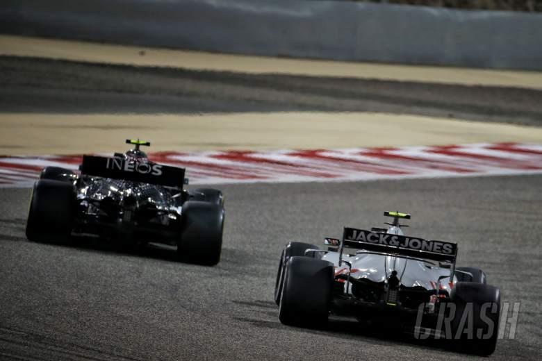 Kevin Magnussen (DEN) Haas VF-20 and Valtteri Bottas (FIN) Mercedes AMG F1 W11.