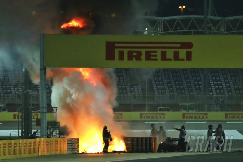 Romain Grosjean (FRA) is pulled clear of his burning Haas VF-20 by Dr Ian Roberts (GBR) FIA Doctor at the start of the race.