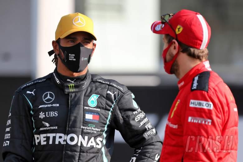 (L to R): Lewis Hamilton (GBR) Mercedes AMG F1 with Sebastian Vettel (GER) Ferrari.