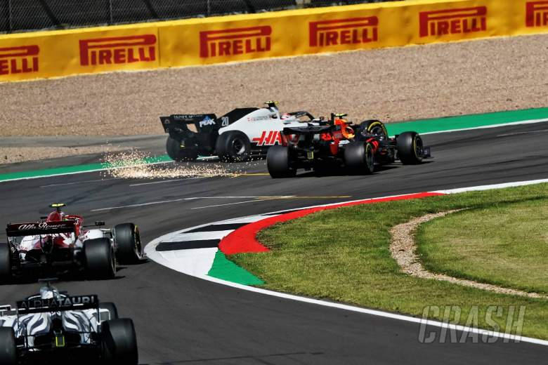 Kevin Magnussen (DEN) Haas VF-20 and Alexander Albon (THA) Red Bull Racing RB16 collide.