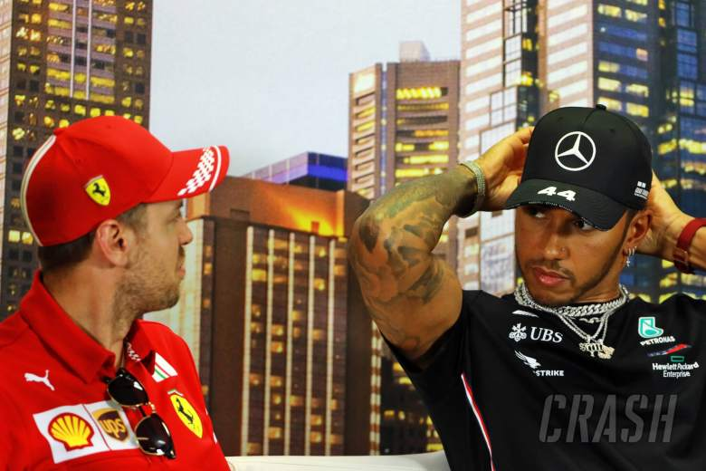 """""""Mixed emotions"""" for Sebastian Vettel over Lewis Hamilton equaling Schumacher's F1 win record"""