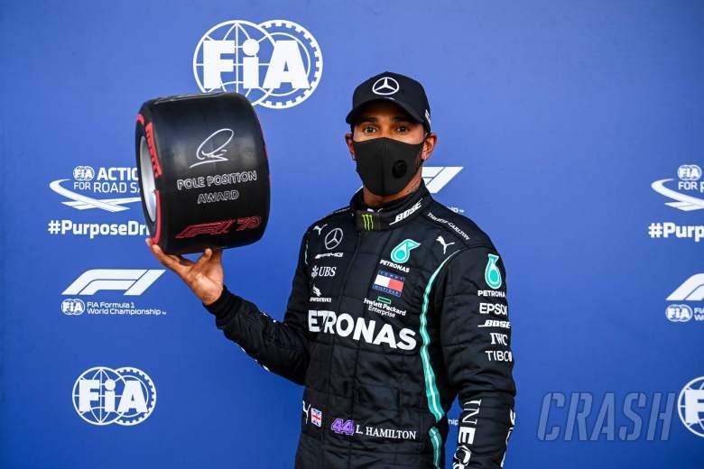 Lewis Hamilton (GBR) Mercedes AMG F1 celebrates with the Pirelli Pole Position Award in qualifying parc ferme.