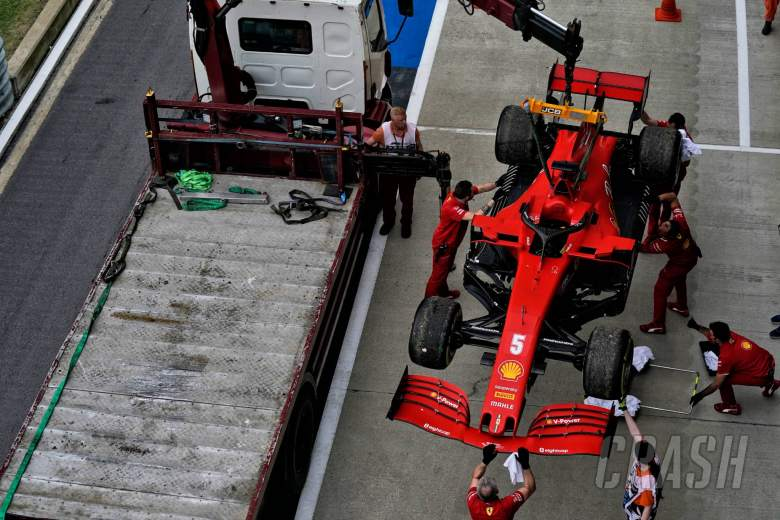 The Alfa Romeo Racing C39 of Sebastian Vettel (GER) Ferrari is recovered back to the pits on the back of a truck in the second practice session.