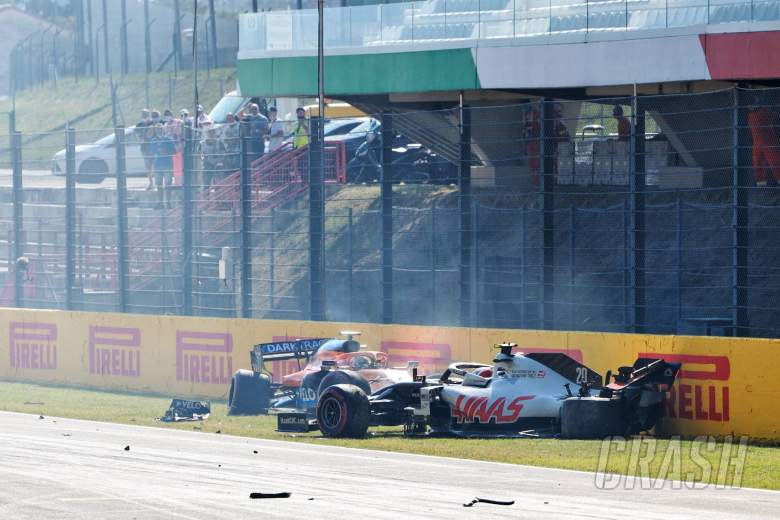 Kevin Magnussen (DEN) Haas VF-20 and Carlos Sainz Jr (ESP) McLaren MCL35 crashed out of the race.
