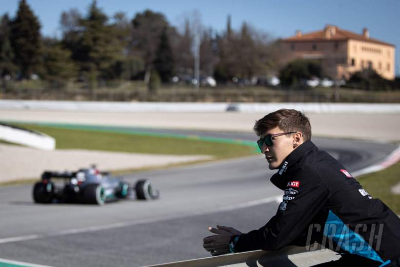 George Russell (GBR) Williams Racing watches Lewis Hamilton (GBR) Mercedes AMG F1 W11.