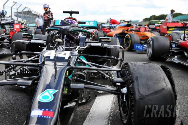 Race winner Lewis Hamilton (GBR) Mercedes AMG F1 W11 in parc ferme with a puncture.