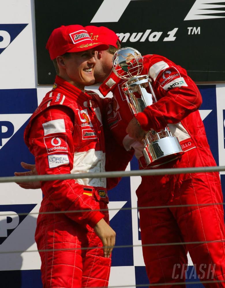 US GP 2002 - Schumacher repays Barrichello favour.