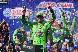 Kyle Busch overcomes speeding penalty to claim landmark win