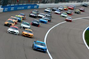 Harvick blasts way to opening Kansas stage win