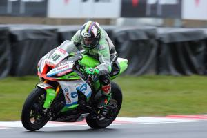 Haslam charges to pole in tricky conditions