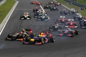 29.07.2012- Race, Start of the race, Romain Grosjean (FRA) Lotus F1 Team E20 and Sebastian Vettel (G