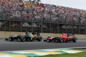 25.11.2012- Race, Vitaly Petrov (RUS) Caterham F1 Team CT01 and Timo Glock (GER) Marussia F1 Team MR