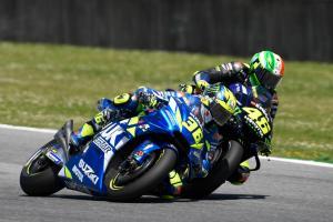 Mir scores points despite Rossi contact