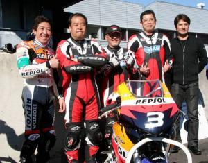 Honda bosses enter mini bike race.
