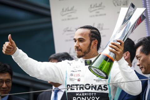 Hamilton eases to Chinese GP victory, tensions flare at Ferrari