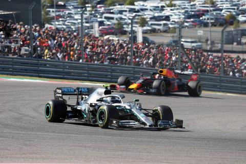 Bottas makes late pass for US GP victory as Hamilton clinches title