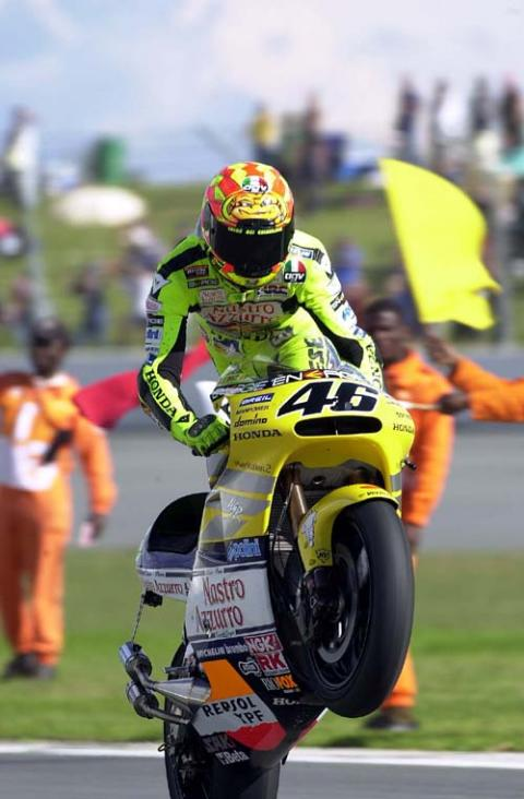 Rossi handed victory as Biaggi bites the dust.