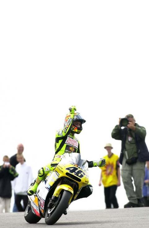 Rossi rules in Estoril - Biaggi crashes again.