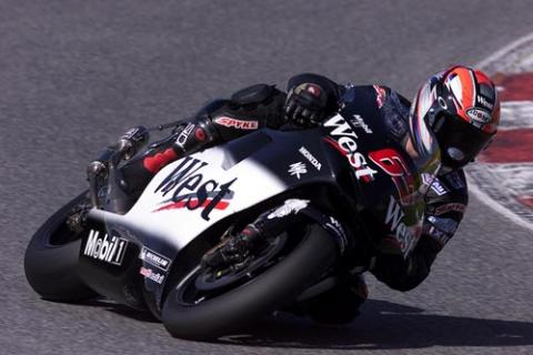 Barros and Capirossi battle for points in rain.