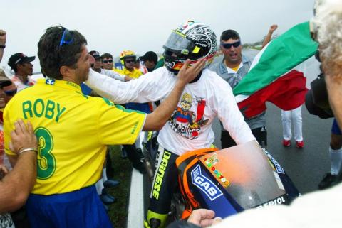 Rossi rides the storm to fourth world title.