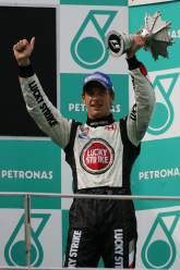 Honda`s Jenson Button celebrates third place in the Malaysian Grand Prix
