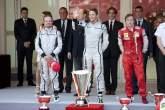 Rubens Barrichello (BRA) Brawn BGP001, Jenson Button (GBR) Brawn BGP001, Kimi Raikkonen (FIN) Ferrar