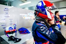 FIA to review helmet design rule after driver backlash
