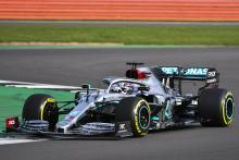 F1 world champion Hamilton drives Mercedes' W11 for first time
