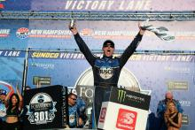 Kevin Harvick survives bump from Denny Hamlin to win New Hampshire 301