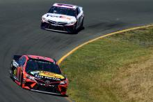 Martin Truex, Jr fends off teammate Kyle Busch for Sonoma race win