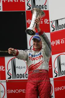 Toyota`s Ralf Schumacher celebrates his third place in the Chinese Grand Prix