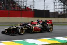 24.11.2013 - Race, Heikki Kovalainen (FIN) Lotus F1 Team E21 and Jean-Eric Vergne (FRA) Scuderia To