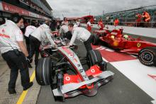 McLaren pay Ferrari costs to end F1 spy row.