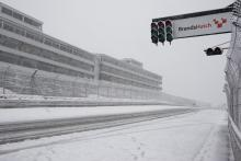 'Snow joke' as conditions frustrate riders.