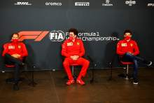 (L to R): Sebastian Vettel (GER) Ferrari; Mattia Binotto (ITA) Ferrari Team Principal; and Charles Leclerc (MON) Ferrari, in the FIA Press Conference.