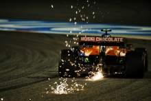 Lando Norris (GBR) McLaren MCL35 sends sparks flying.