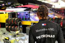 Lewis Hamilton (GBR) Mercedes AMG F1 in the pits while the race is stopped watches a replay of the crash suffered by Romain Grosjean (FRA) Haas F1 Team at the start of the race.