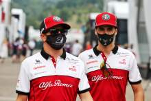 (L to R): Kimi Raikkonen (FIN) Alfa Romeo Racing with Antonio Giovinazzi (ITA) Alfa Romeo Racing.