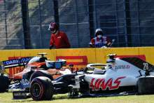 The Haas VF-20 of Kevin Magnussen (DEN) Haas F1 Team and the McLaren MCL35 of Carlos Sainz Jr (ESP) McLaren crashed out of the race.