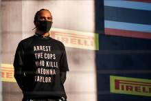 FIA bans F1 drivers from wearing T-shirts on Russian GP podium