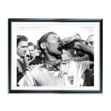 Do you fancy owning an exclusive signed photo of Sir Stirling Moss?