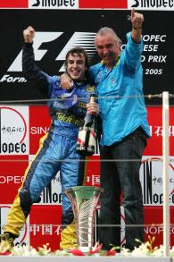 Chinese GP race winner Fernando Alonso and Flavio Briatore celebrate helping Renault to the construc